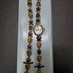 Avon silver tone tiger's eye & onyx watch set